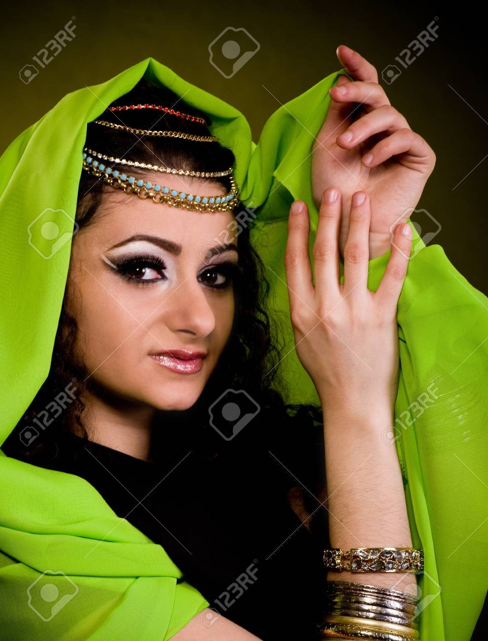 Beautiful young woman in color arabian clothes Stock Photo - 12522040