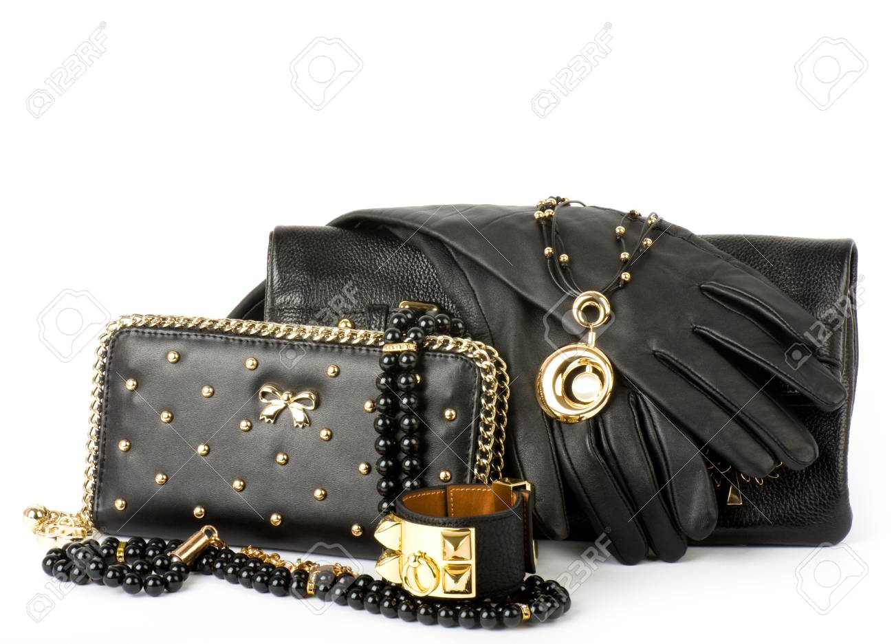 Sexy fashionable handbag and golden jewelry on white background Stock Photo - 12886203