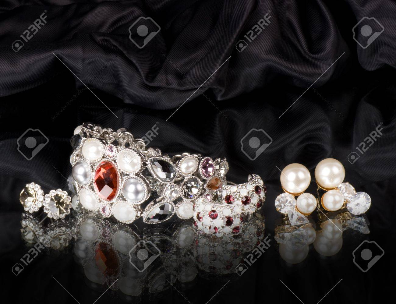 Silver jewelry on black background Stock Photo - 12886076