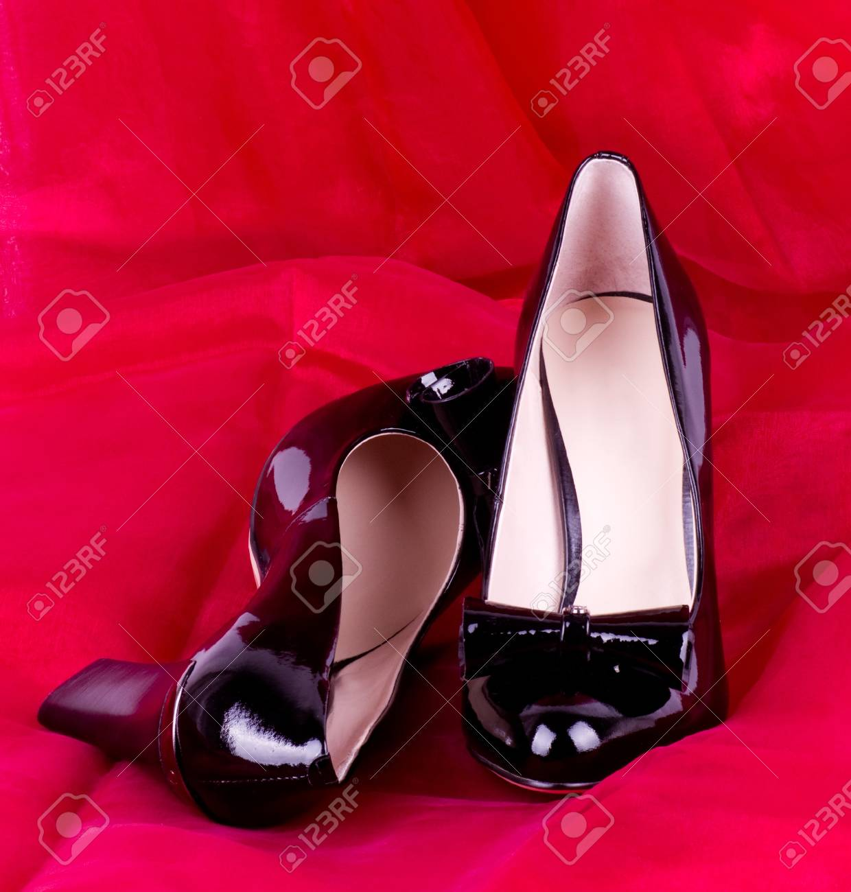 Sexy fashionable shoes on red background Stock Photo - 13081800
