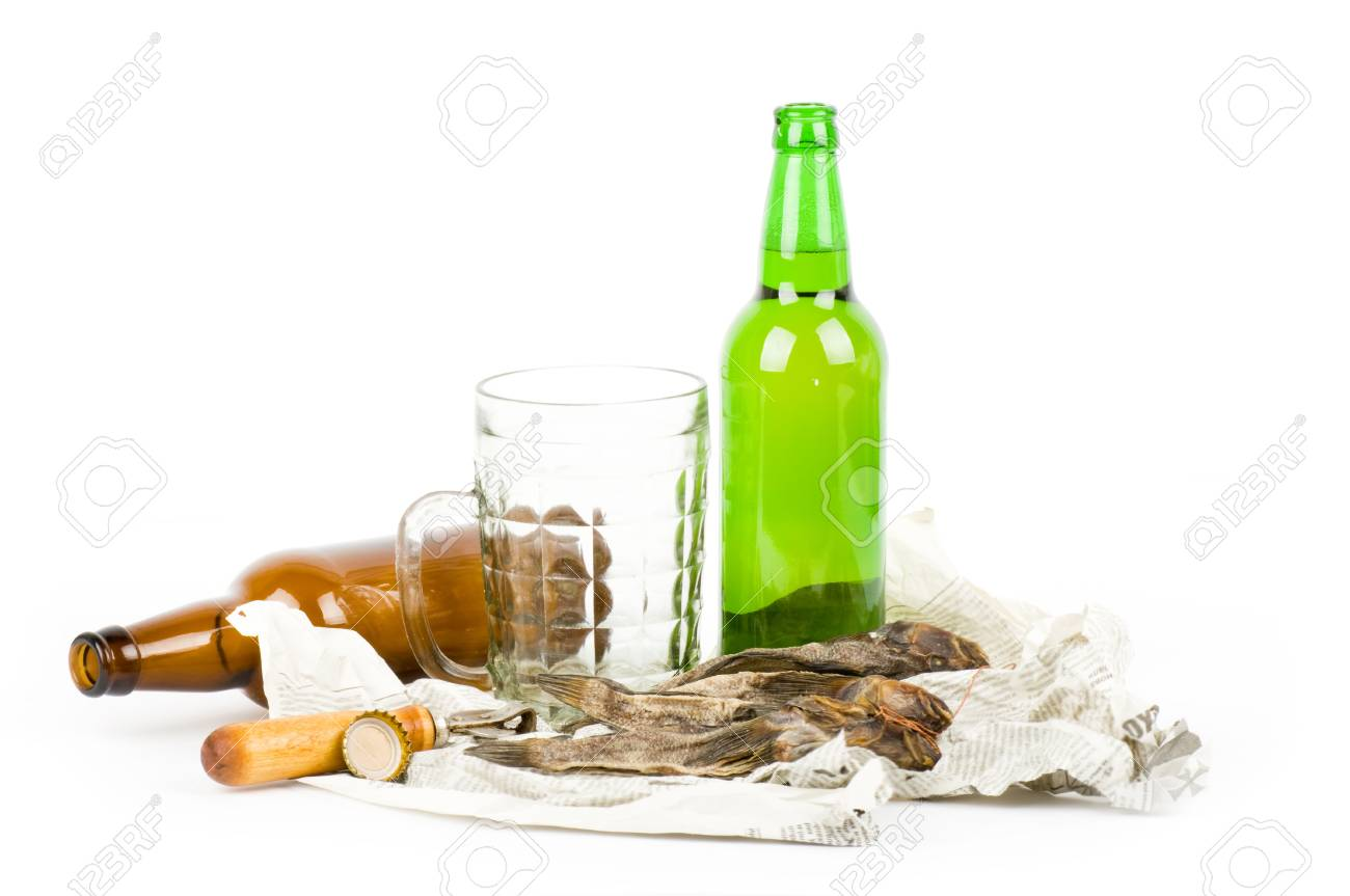 Hand with beer brown bottle isolated on a white Stock Photo - 13663122