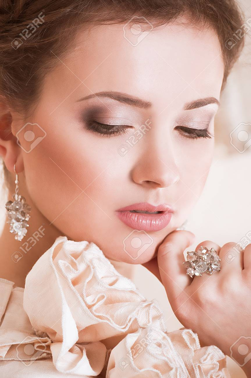 Portrait of beautiful young woman with makeup Stock Photo - 16621030