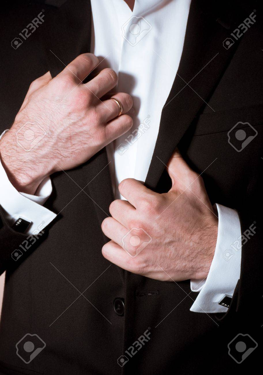 Closeup of a man in black suit with cuff-link Stock Photo - 17133063