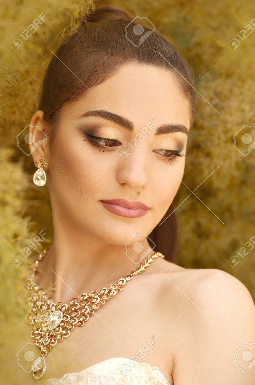 White dress and makeup - Beautiful Bride With Stylish Make Up In White Dress Stock Photo 20419747