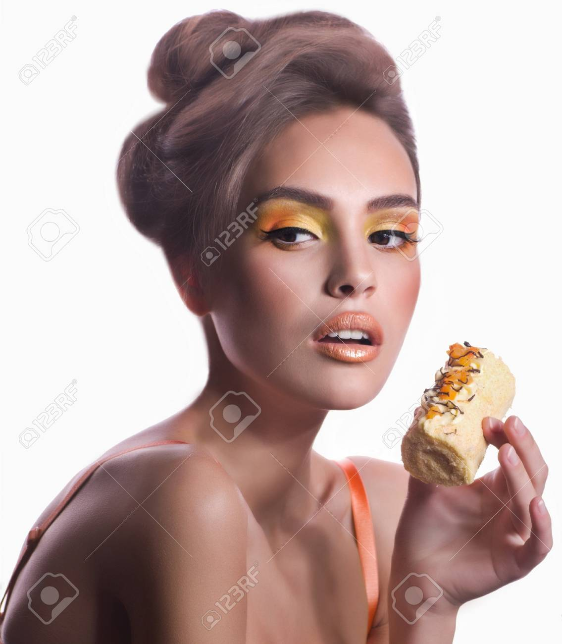 Beautiful fashion girl with delicious orange praline Stock Photo - 21227604