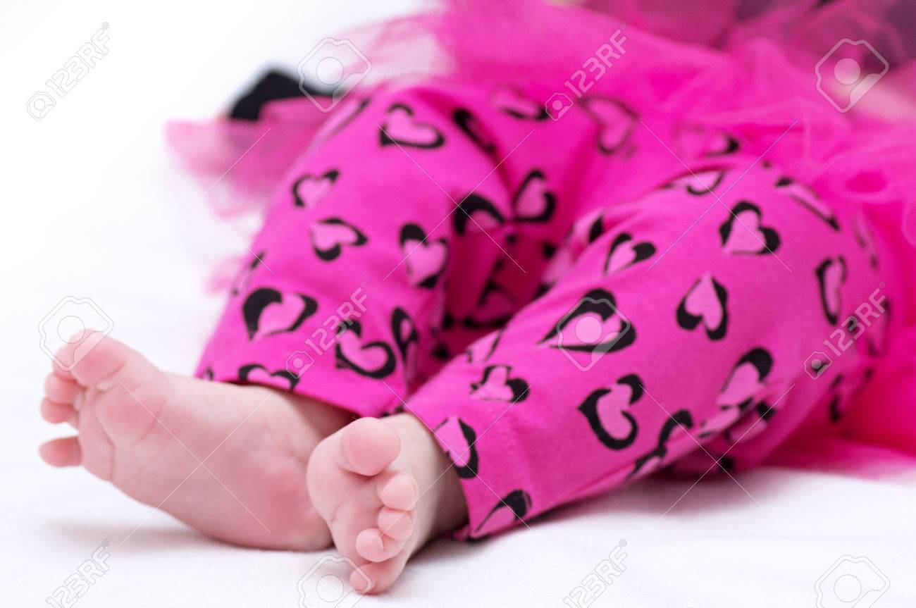 newborn baby girl feet in pink clothes stock photo picture and