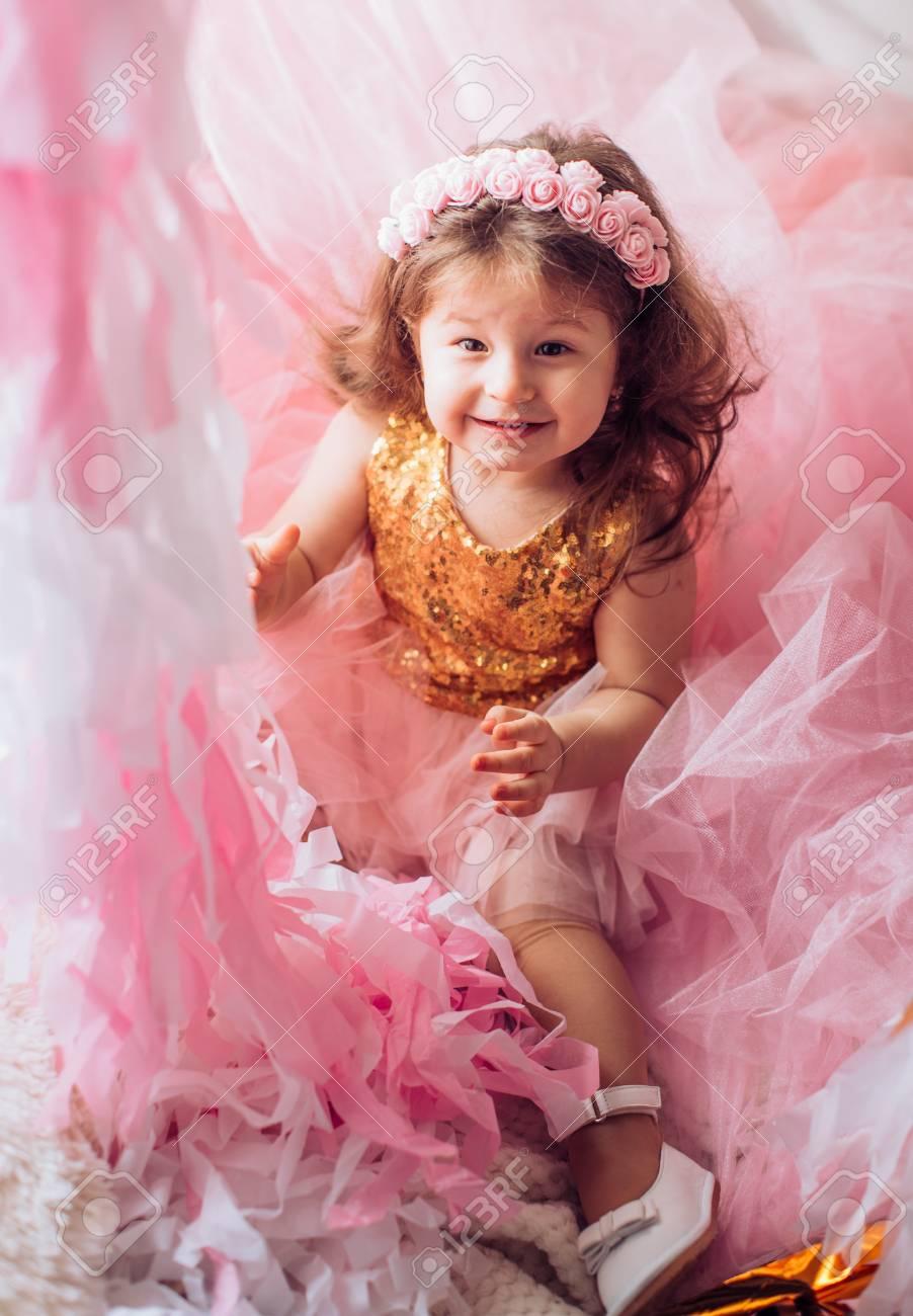 acd7e1214 Beautiful little girl celebrating birthday party. Family celebration..