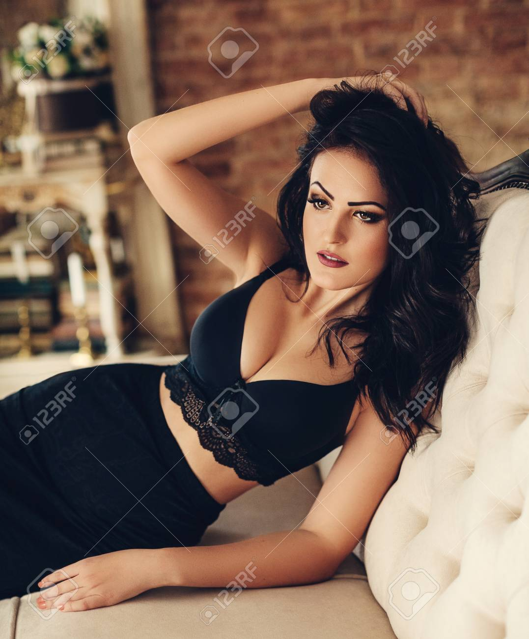 af6f0553db1 Sexy beautiful brunette woman in black underclothes Stock Photo - 110578086