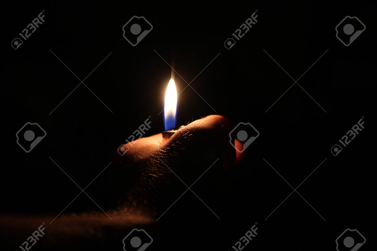 Hand holding a flame Stock Photo - 17320964