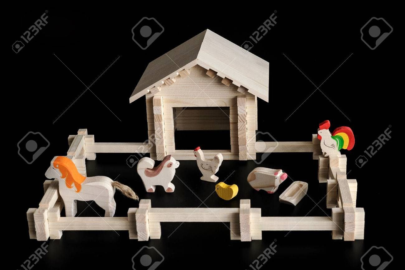 A Small Wooden House Building Kit Toy Farm On A Black Background