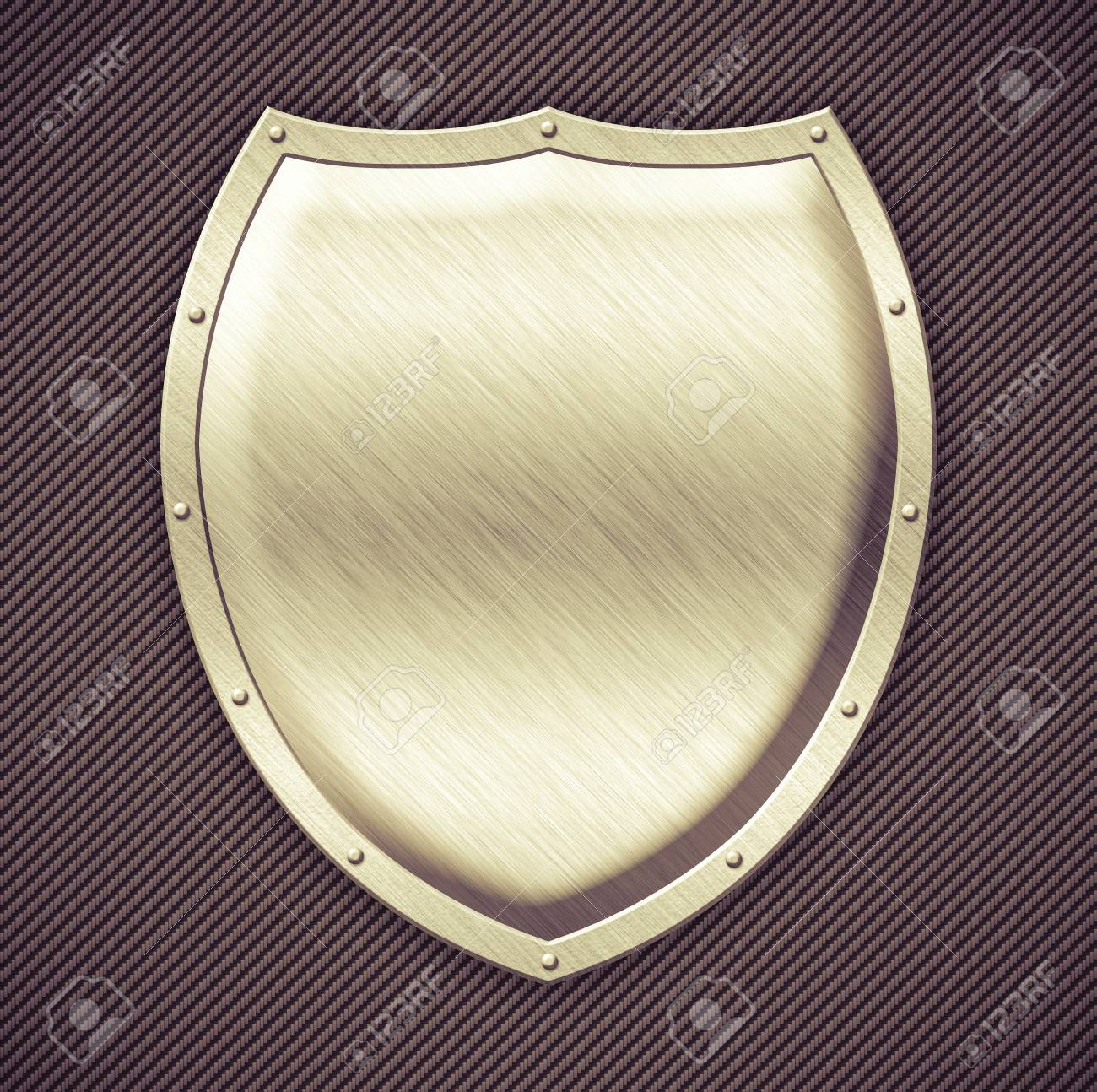 Aged metal shield on carbon background Stock Photo - 18144457