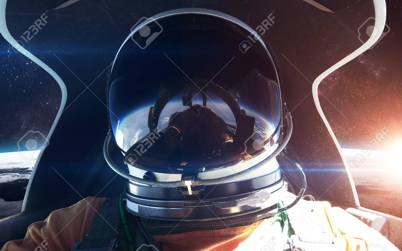 Brave Astronaut In The Spaceship Cabin Stock Photo