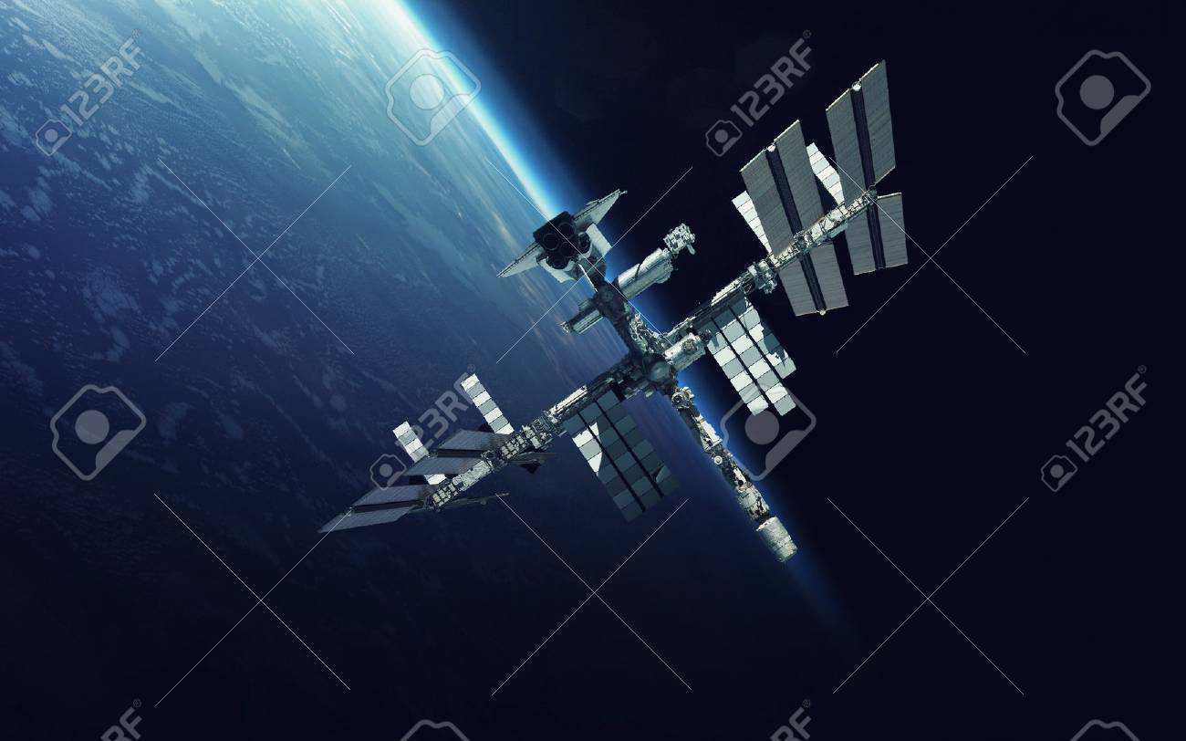 International Space Station over the planet Earth. - 69540028