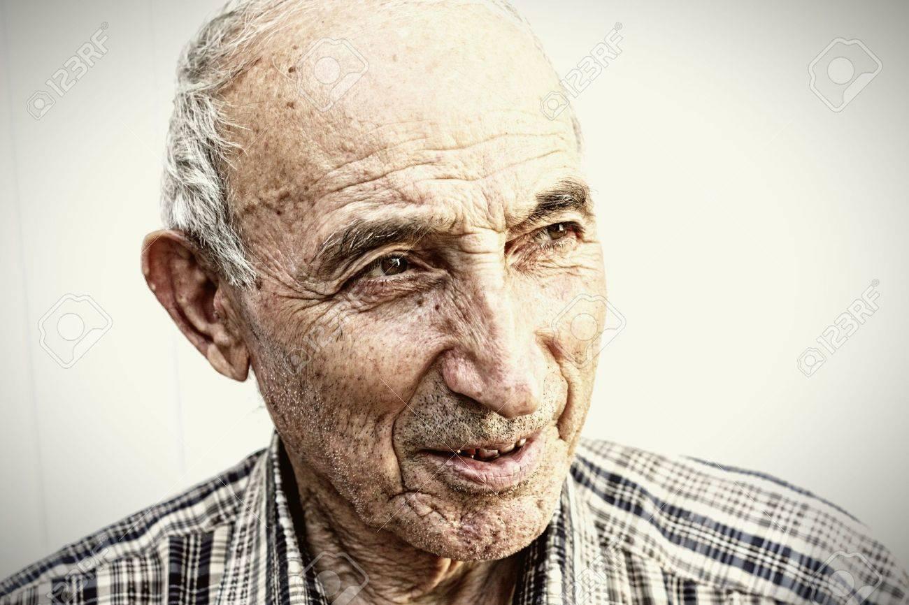 Thoughtful elderly man looking aside closeup portrait Stock Photo - 5372302