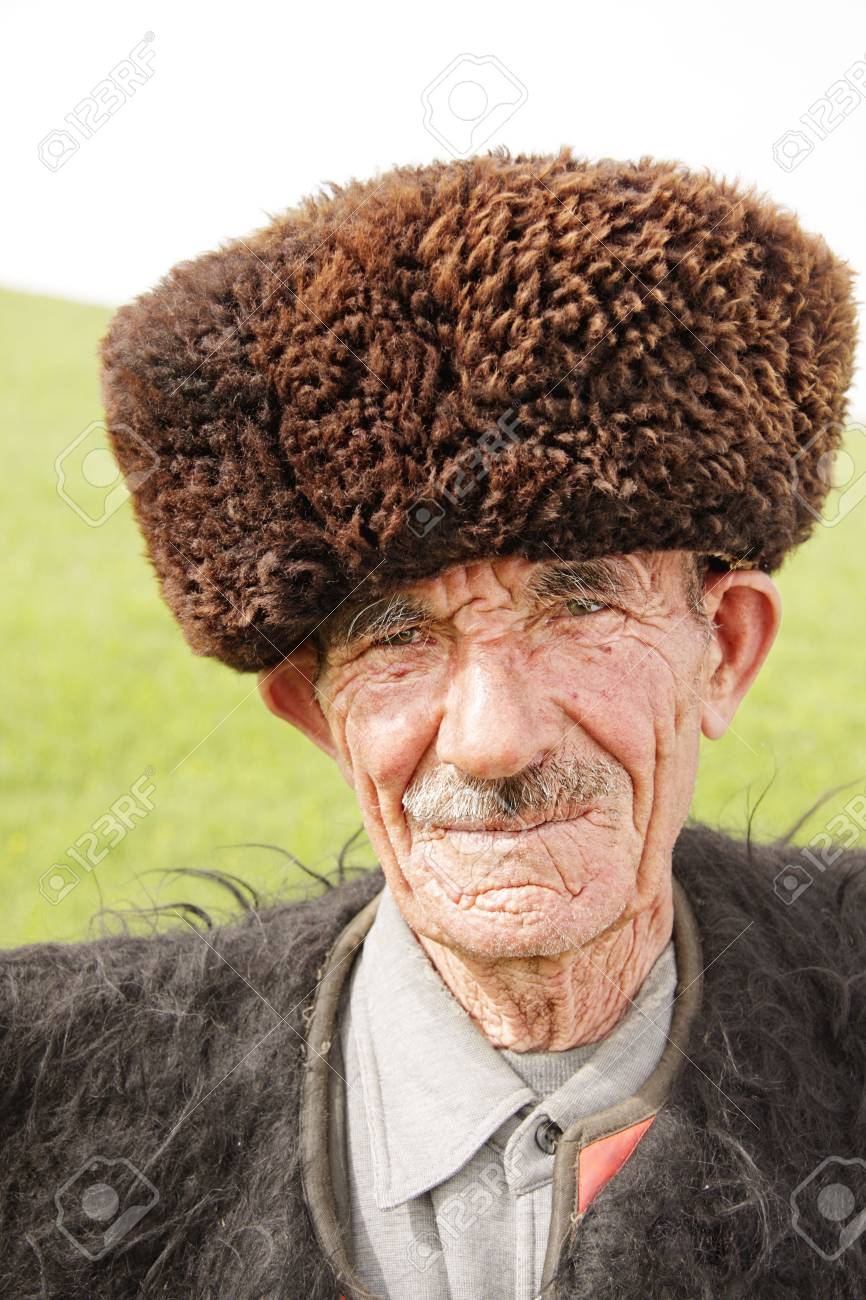 Old man in traditional clothes outdoor closeup portrait Stock Photo - 5638179
