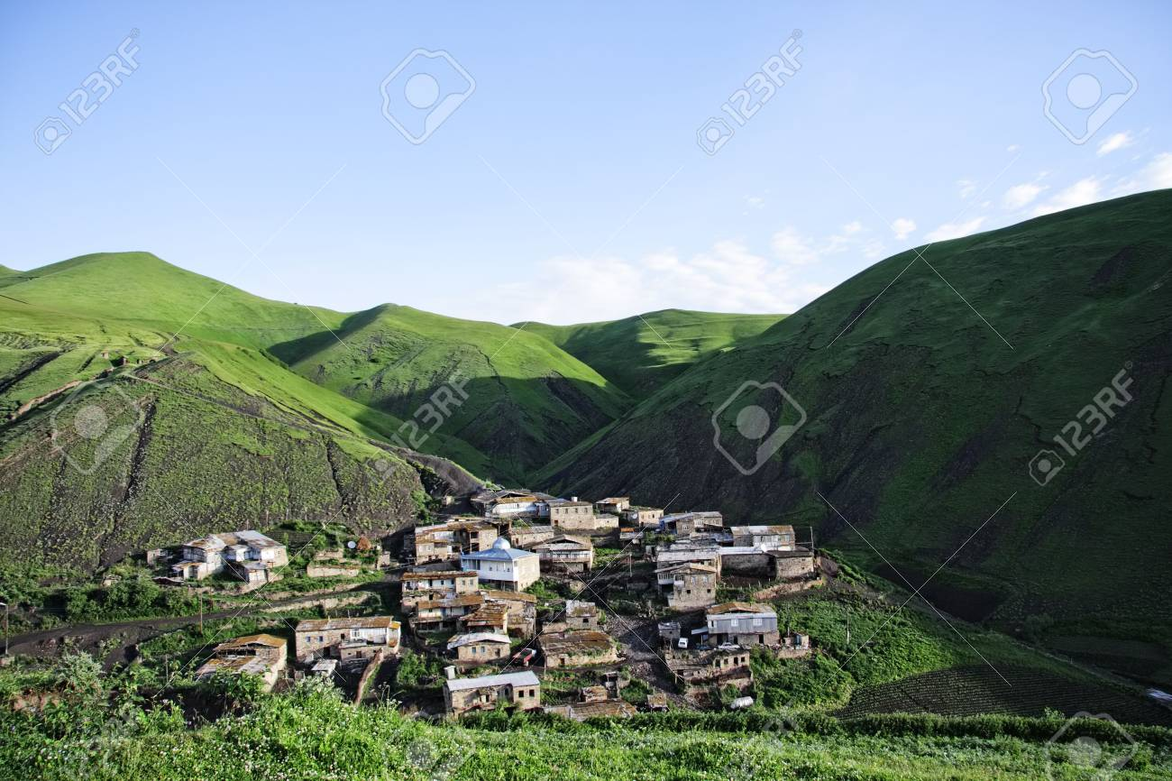 Small village hiding in mountains in sunny summer day Stock Photo - 6423089