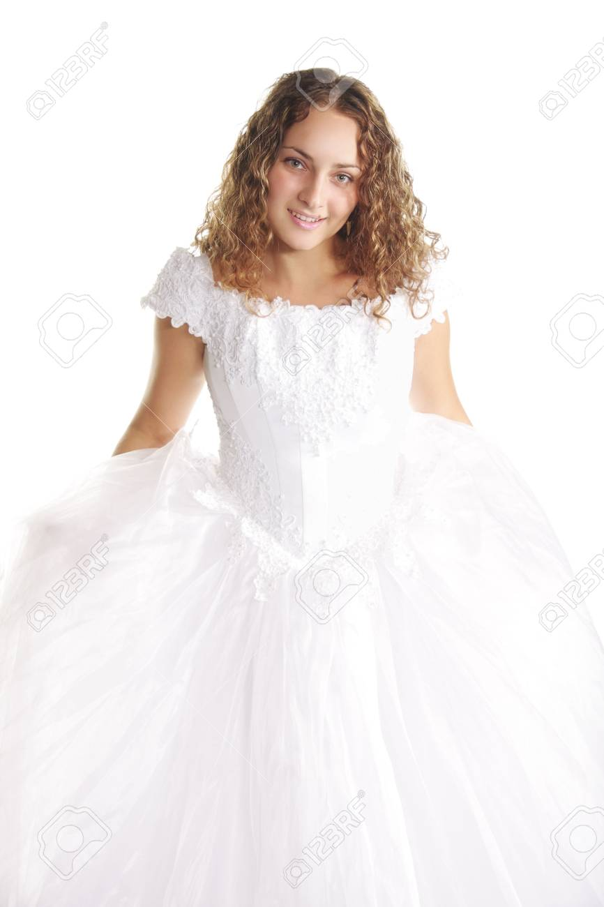 Smiling curly bride in long dress against white background Stock Photo - 6620930