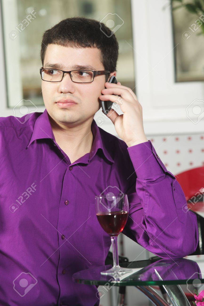 Guy Wearing Purple Shirt Sitting In Cafe With Cellphone Stock ...