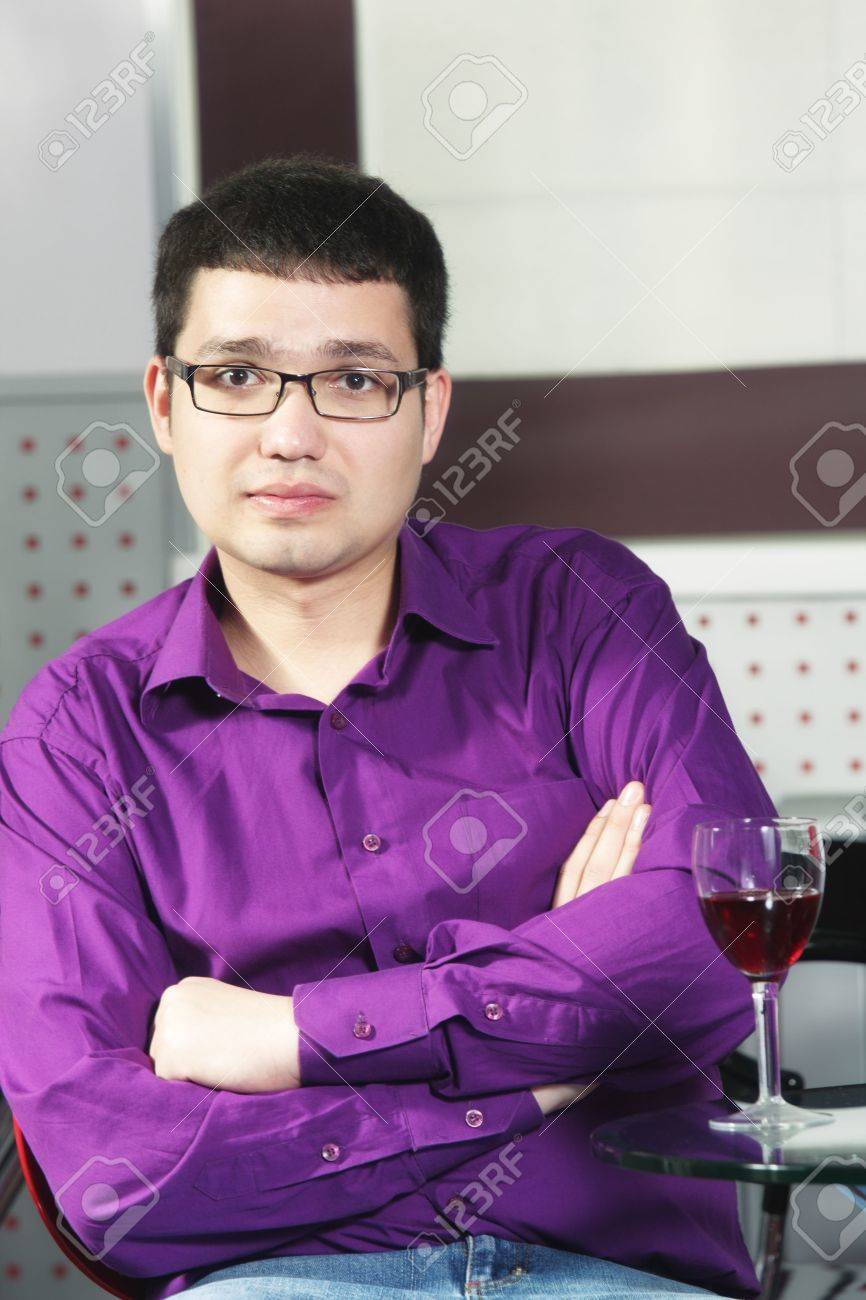Guy Wearing Purple Shirt Sitting In Cafe With Glass Of Red Wine ...