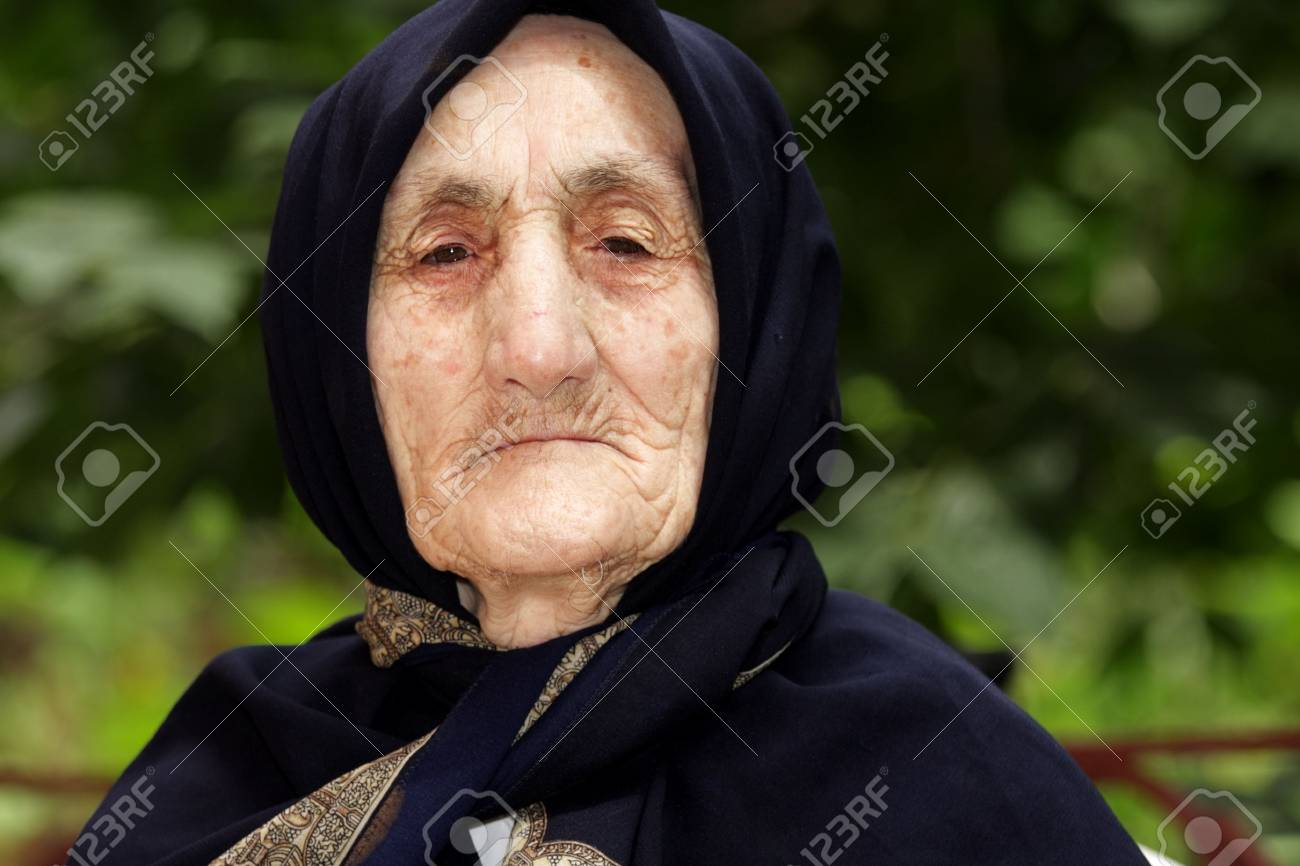 Portrait of strict elderly woman looking to camera outdoors Stock Photo - 7757203