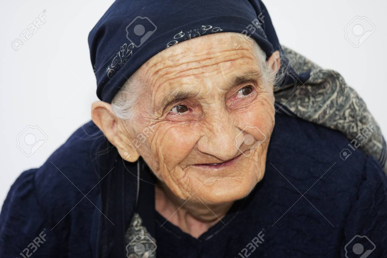 Closeup portrait of cute smiling elderly woman looking sideways Stock Photo - 8022373