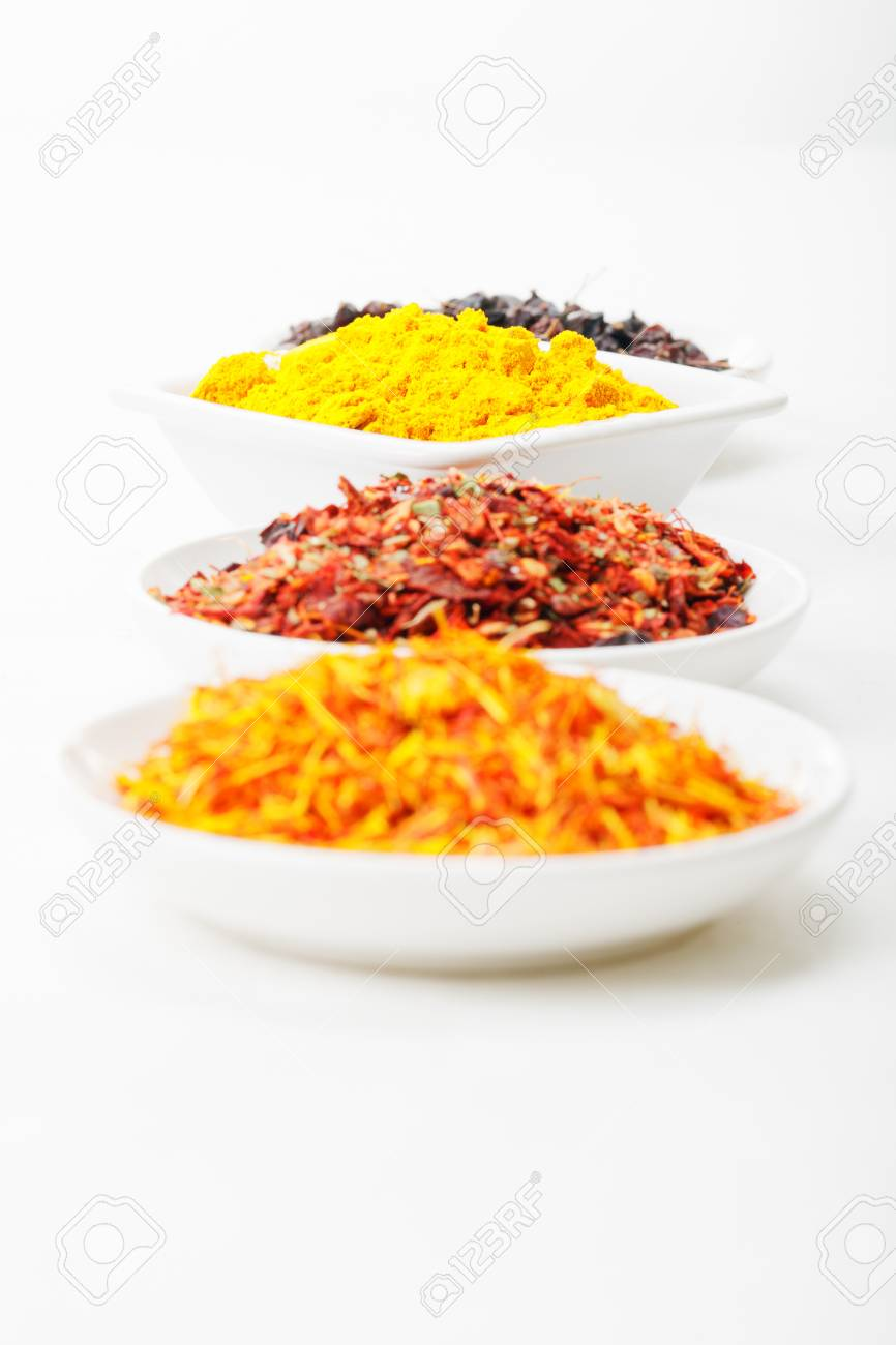 Square dish among rounded filled with various spices Stock Photo - 8176623