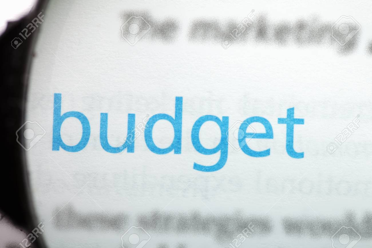 Budget word printed on page seen through magnifier Stock Photo - 9248985