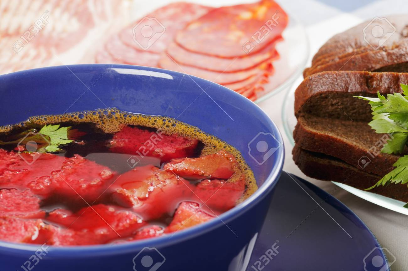 Beet soup with meat and bread on tablecloth closeup photo Stock Photo - 9224037
