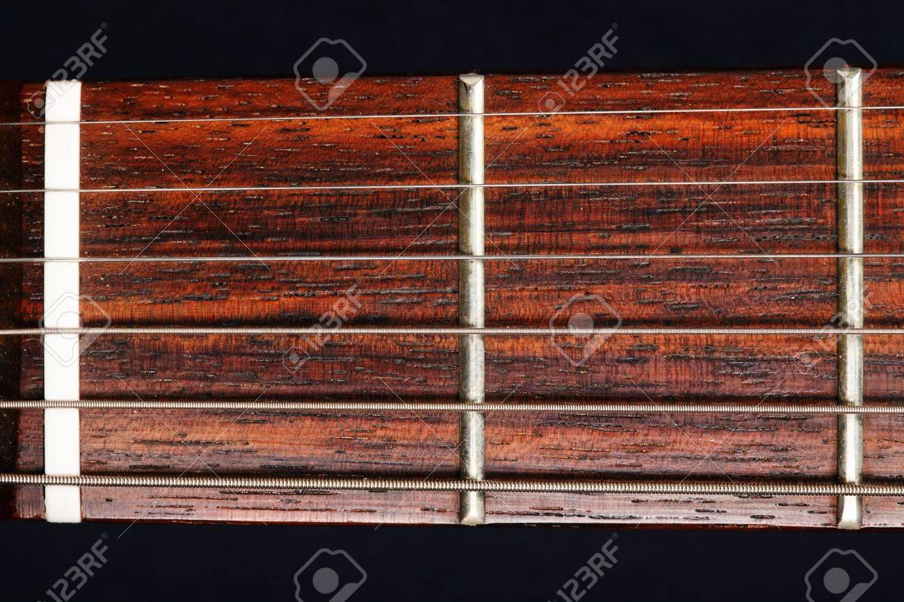 Guitar neck closeup photo against dark background Stock Photo - 9224897