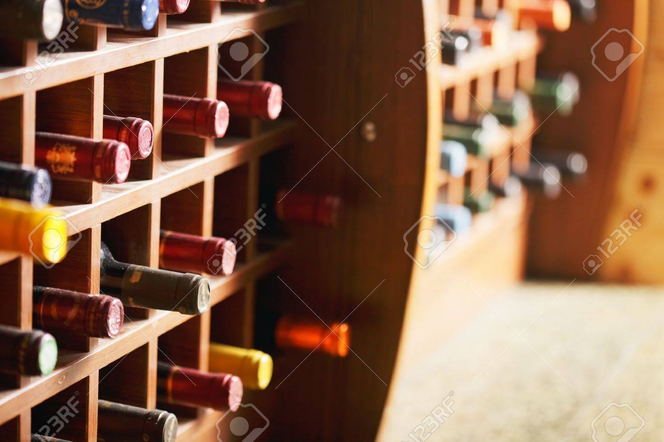 Wooden cells with collection of old wine bottles Stock Photo - 9223726