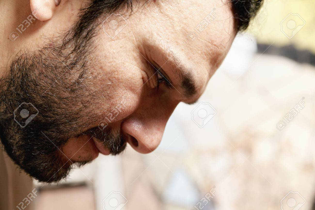 Bearded middle-aged man bending forward face closeup Stock Photo - 11870408