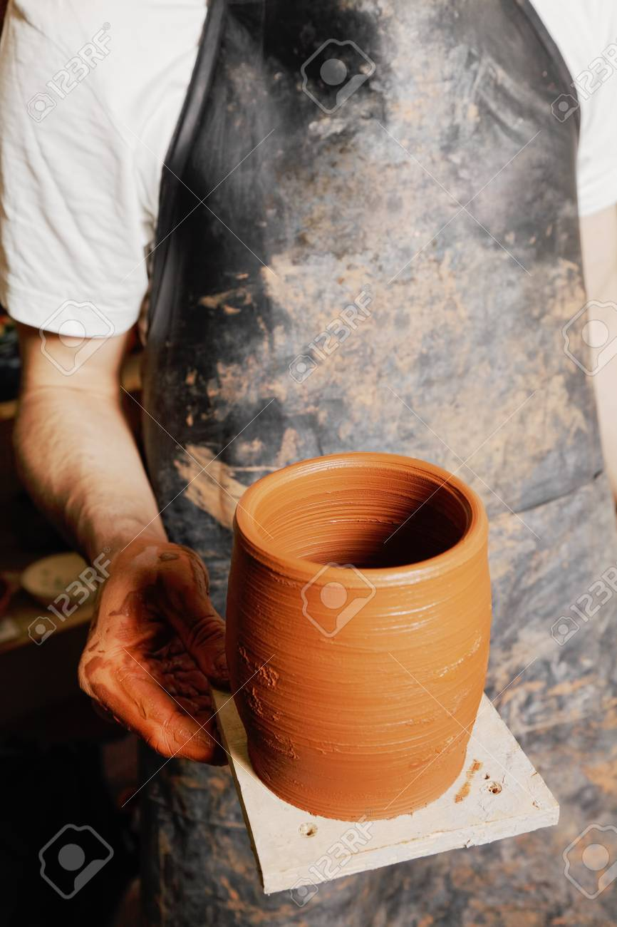 Hand of potter with jug closeup photo Stock Photo - 11870427
