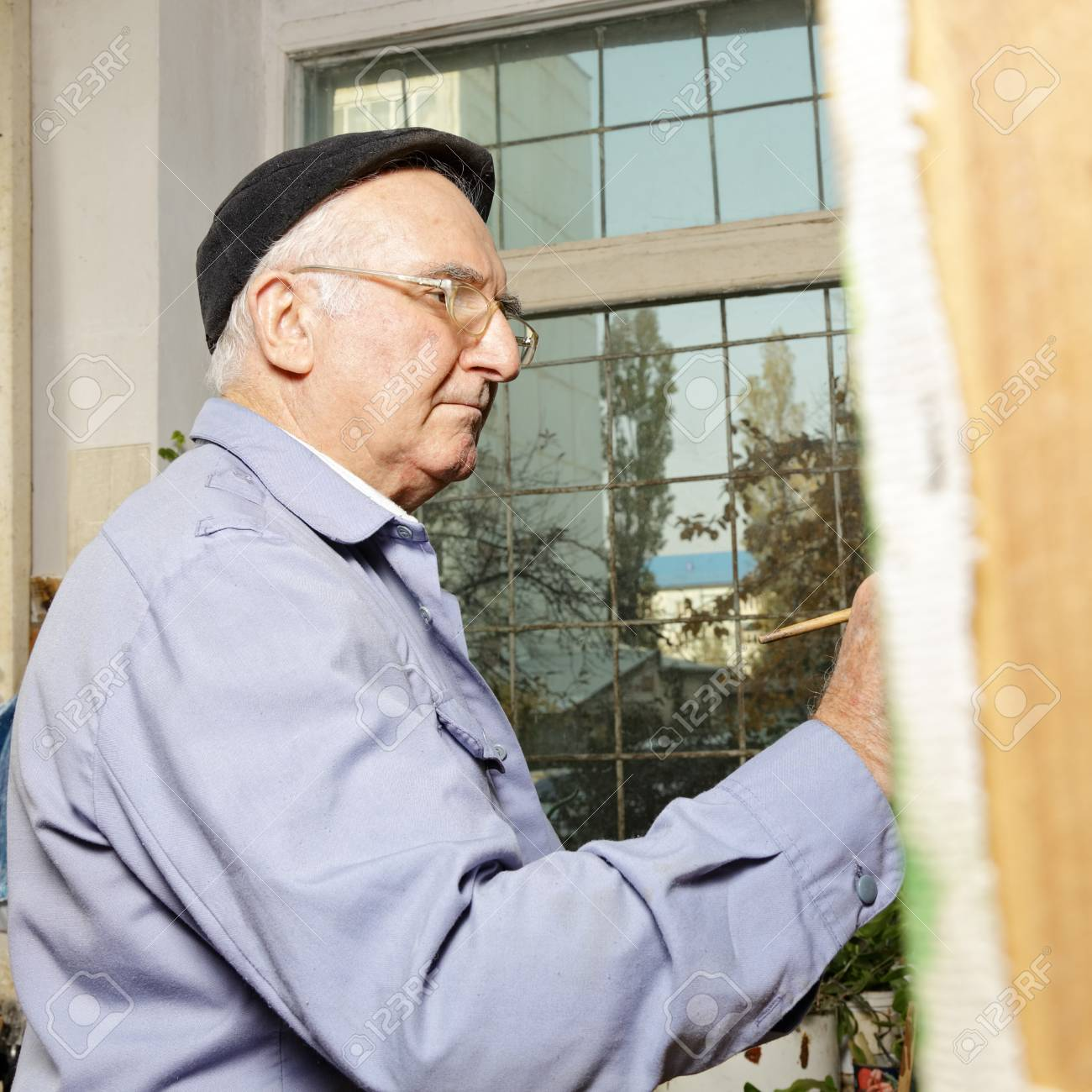 Artist at work painting picture in workshop sideview Stock Photo - 15862869