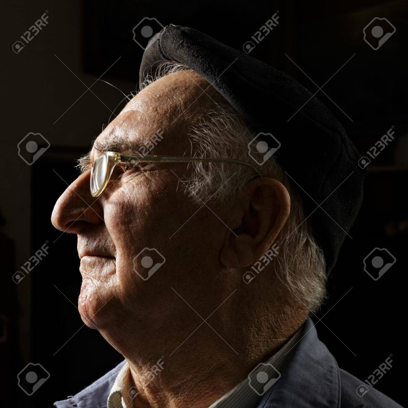 Senior in cap and eyeglasses sideview head and shoulders portrait Stock Photo - 15862888