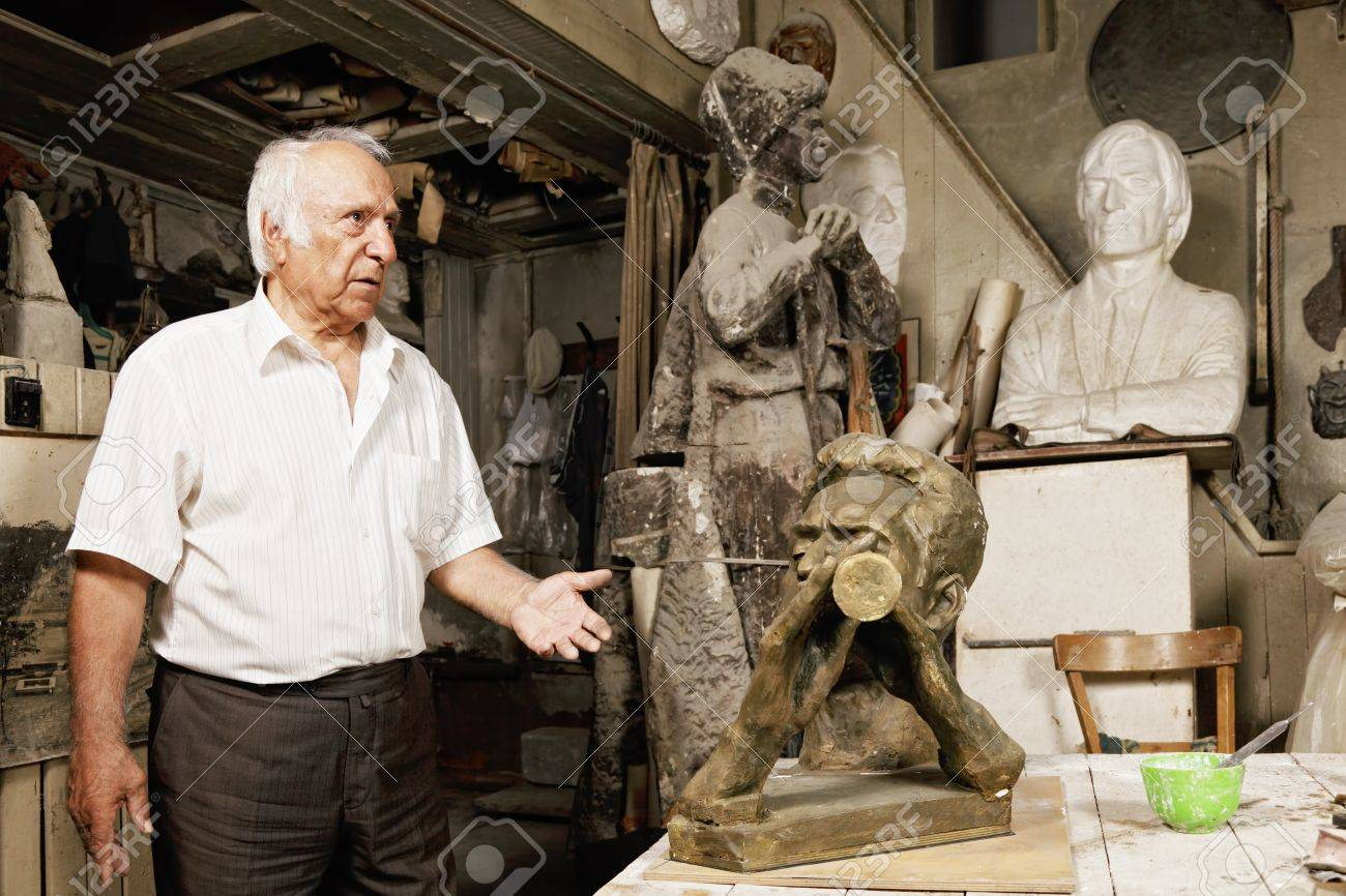Senior sculptor showing his works in workshop Stock Photo - 16469209