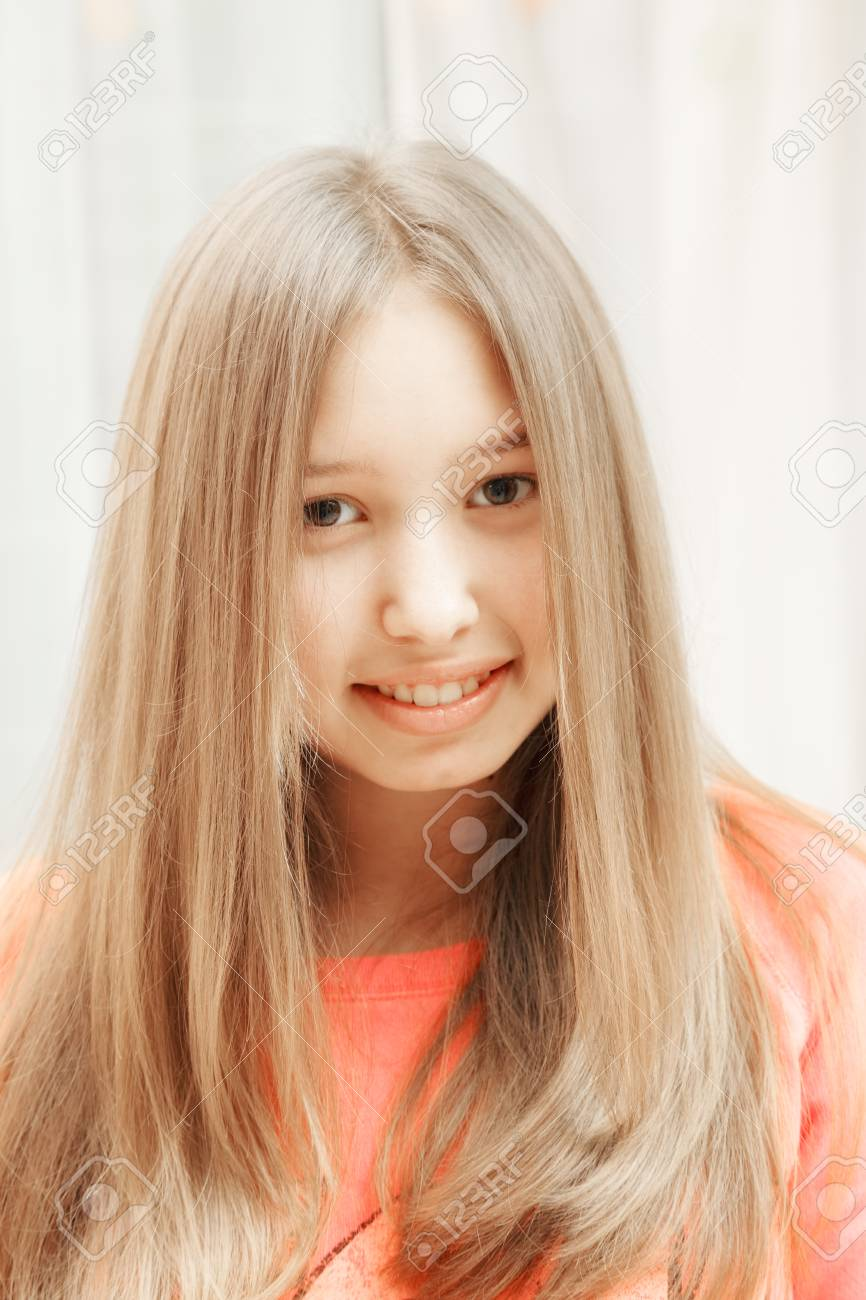 Positive teenage girl in red sweater Stock Photo - 18496421