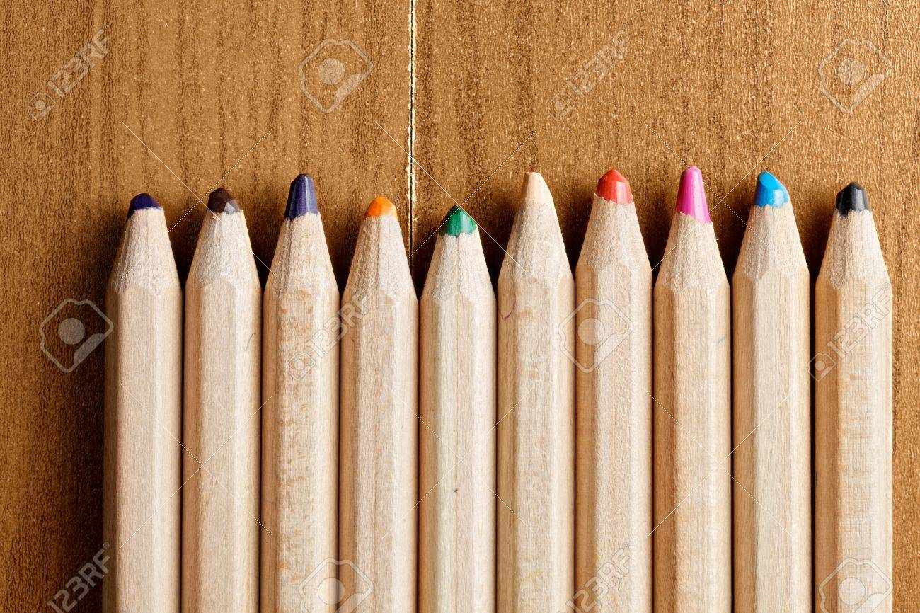 Row of pencils over wooden surface closeup photo Stock Photo - 20735633
