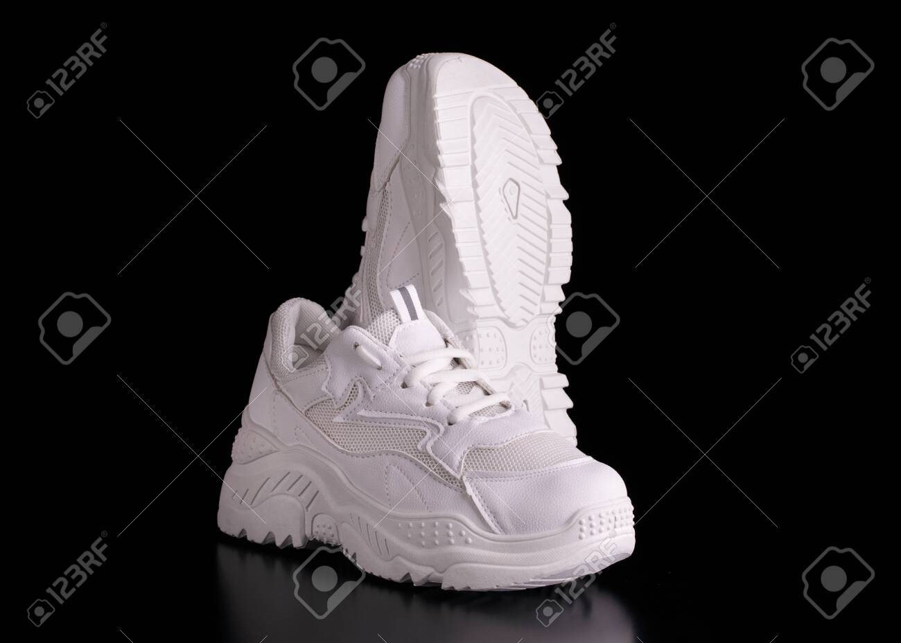 Black Background. Fashionable Sneakers
