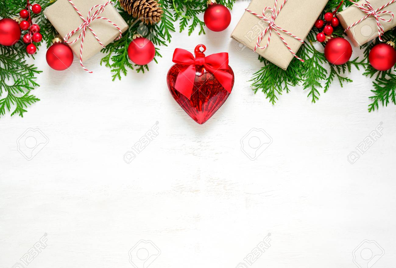stock photo xmas or new year background holiday plain composition made of christmas decorations and fir twigs on a wooden background flat lay view from
