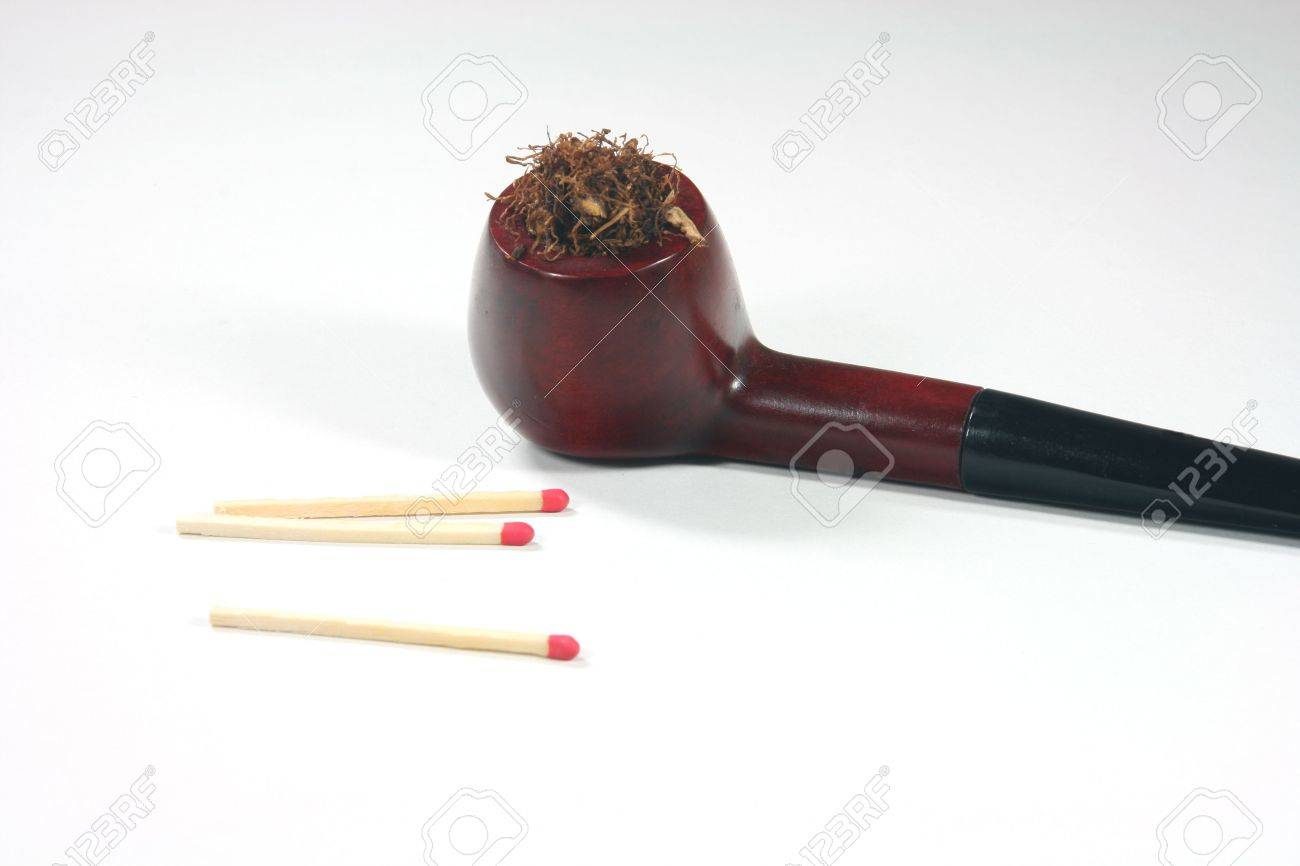 old wooden tobacco pipe with matches in white background