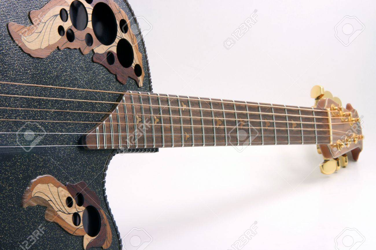 perspective view of black guitar and strings music equipment on white background - 2038542
