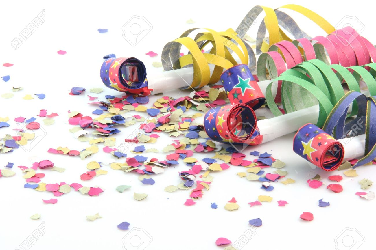party concepts paper confetti with streamers and four party blowers on white background - 2576317