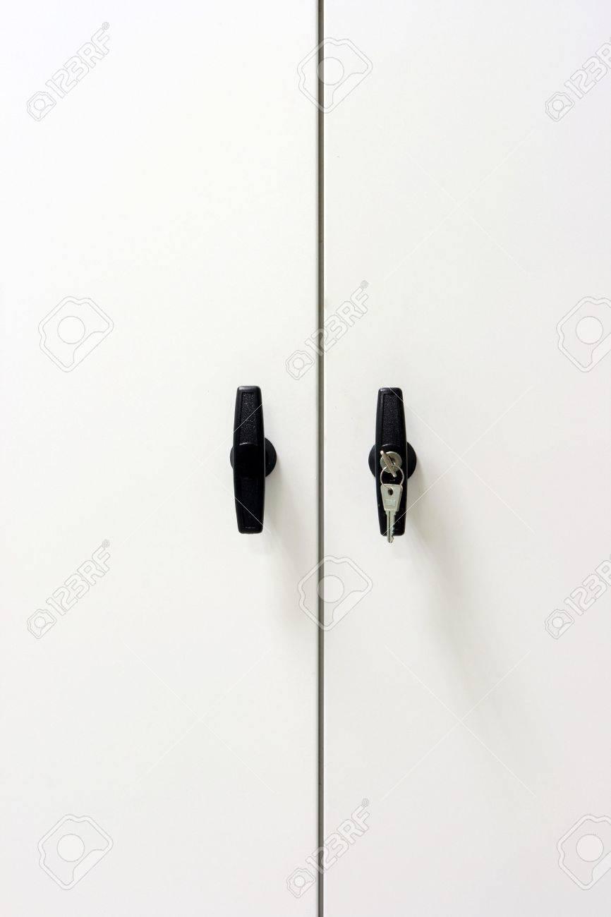 white metallic closet detail black handles with keys vertical Stock Photo - 3477987