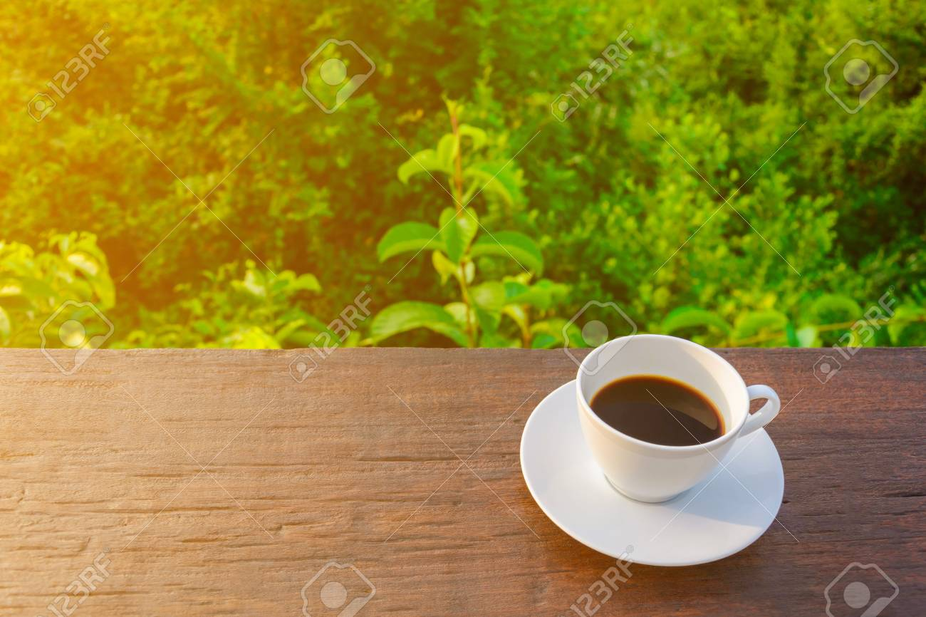 Coffee Cup Clock On Old Wooden Table Nature Background The Good Stock Photo Picture And Royalty Free Image Image 79761118