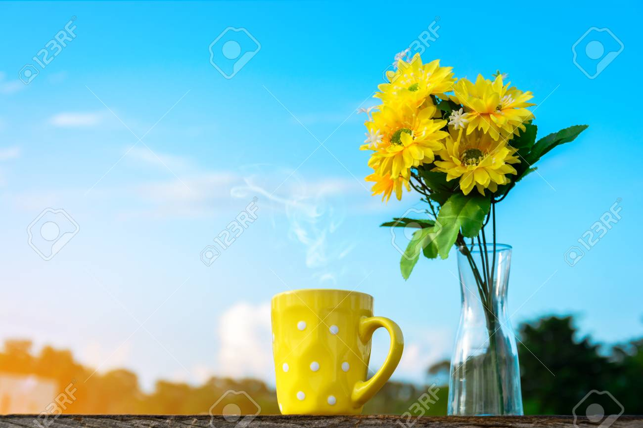 Good morning coffee cup and yellow flower vase on a wooden table good morning coffee cup and yellow flower vase on a wooden table in the sunrise sky mightylinksfo