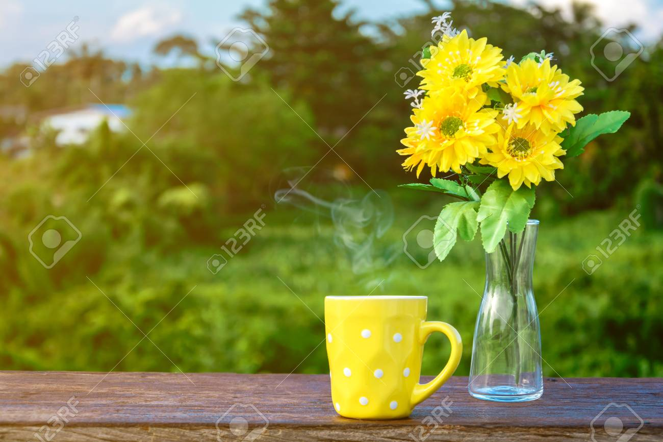 Good Morning Coffee And Yellow Flower Vase On A Wooden Table Stock