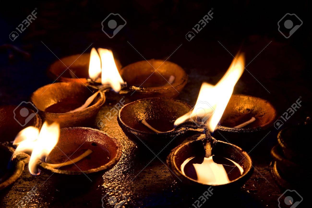 Burning candles at altar in buddhist temple, Sri Lanka