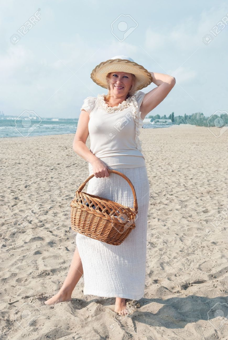 mature women walking on a beach stock photo, picture and royalty