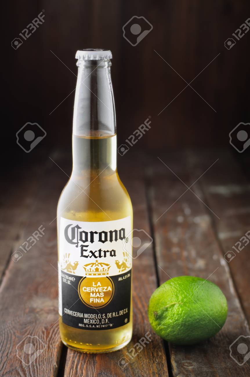Editorial Photo Of Corona Beer With Lime On Wooden Background Stock Photo Picture And Royalty Free Image Image 81980600