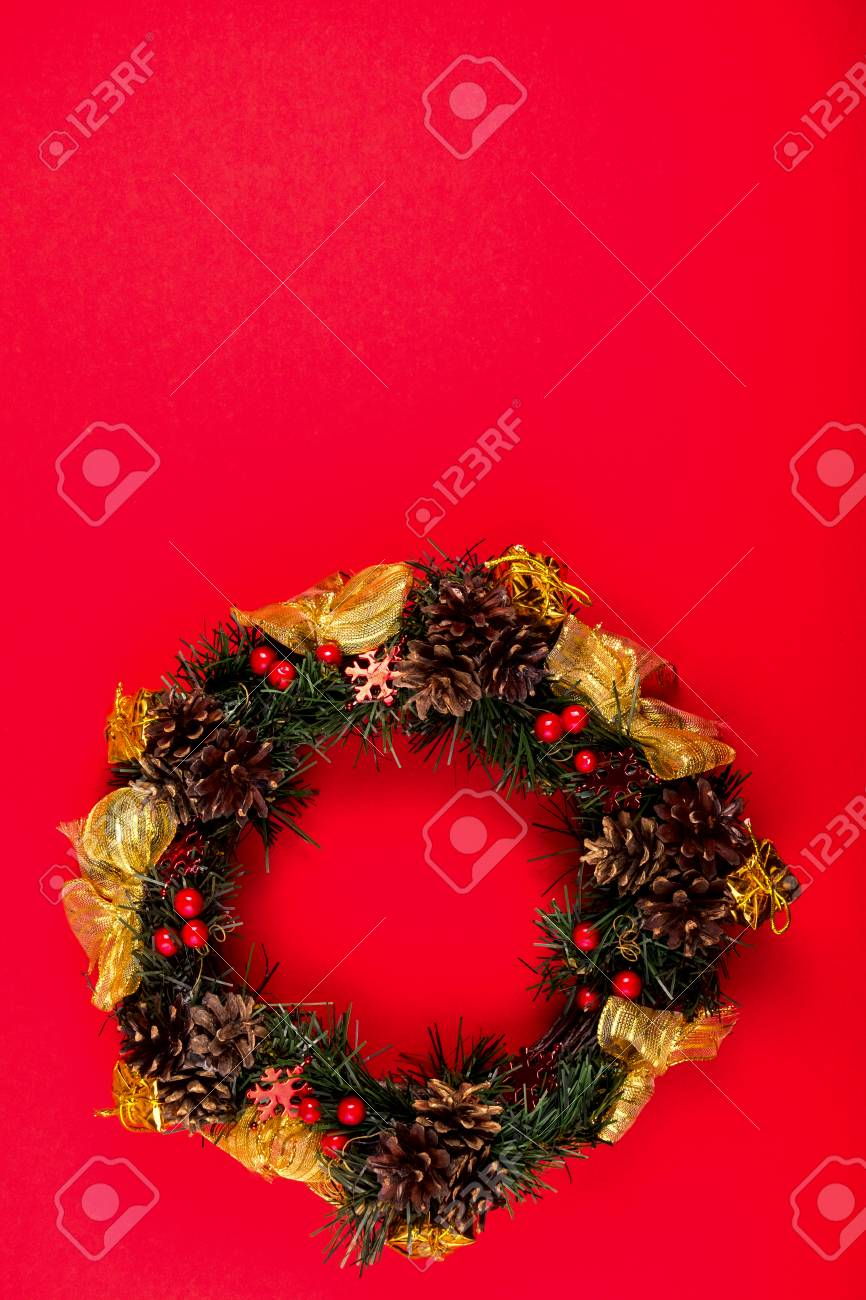 Christmas Wreath, Holiday Composition On A Red Background. Top View Stock  Photo   89057955